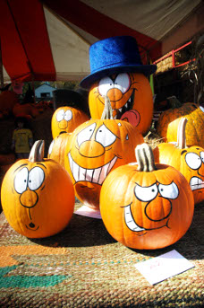 Pumpkins with faces painted on them